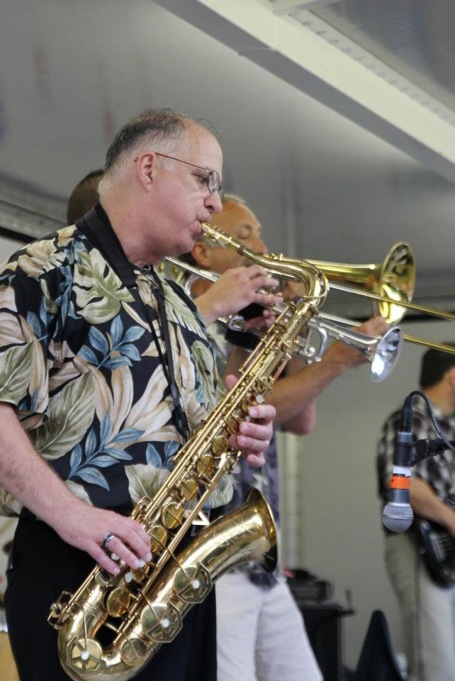 Joe Pellerito plays the Synthophone, an electronic saxophone, as well as Soprano, Alto, Tenor and Bari Saxes, keyboards and guitar; he is also the musical director of SoulQuest. His musical experience spans four decades beginning at Michigan State University where he played in the MSU Marching Band, Symphony Band and Jazz Band, showing his versatility as a musician. Since 1990, he has been part of the MSU Alumni Band. Joe met up with Ric and Ron in 2004 when they joined Soul Driven. His musical heroes include The Beatles, Illinois Jacquet, and Doc Severinsen. Joe grew up in Dearborn Heights, MI and now lives in Troy.