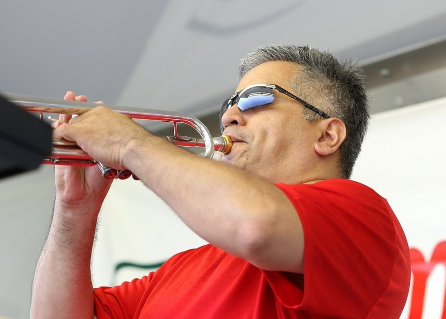 Because of his 30-plus years of playing trumpet and flugelhorn, Ric Guajardo brings a wide-open and soulful sound. He also plays harmonica, keys and helps out with vocals. An accomplished performer whose technical skill is used as a means to stimulate original ends, Ric arranges and composes music for the SoulQuest horn section. He has recorded and performed with many local artists at a variety of venues and festivals. In the 80s, he played with Midwest Rumor (later called Exodus) along with SoulQuest horn man, Ron Martin; then in 2008, he joined the horn section of Soul Driven, with SoulQuest mates Ron Martin and Joe Pellerito. By day, Ric works as a video editor for WJBK-FOX2 News. Ric performed with The Drifters featuring Charlie Thomas in 2012 for a Christmas performance at Meadowbrook Music Hall. In addition to his musical talents, Ric is a professionally trained Mexican folkloric dancer. Ric's musical heroes are Louie Armstrong, Herb Alpert, Miles Davis, Chuck Mangione, and Maynard Ferguson. He was born in Detroit, MI, and grew up in Taylor, the city he still calls home.